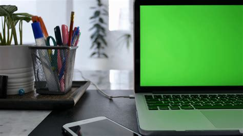 Laptop Computer Showing Green Chroma Key Screen Stands on